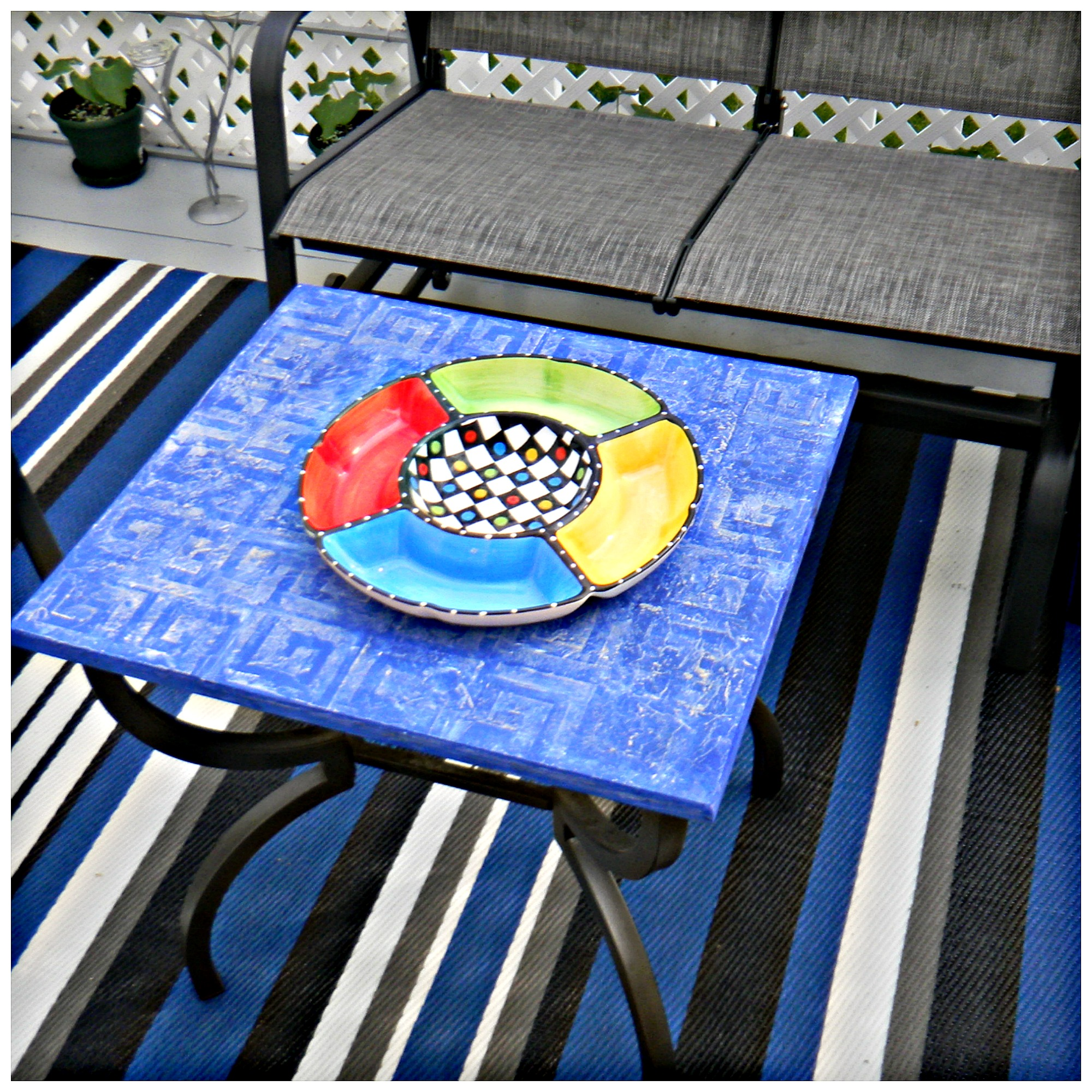 restored painted outdoor coffee table 8 DIY Patio Accents #trashtotreasure #patio #diy #yard #garden #up-cycle #re-purpose #patio_table #plant_stand #bird_bath #herb_garden #wineglass #martiniglass #candles #art
