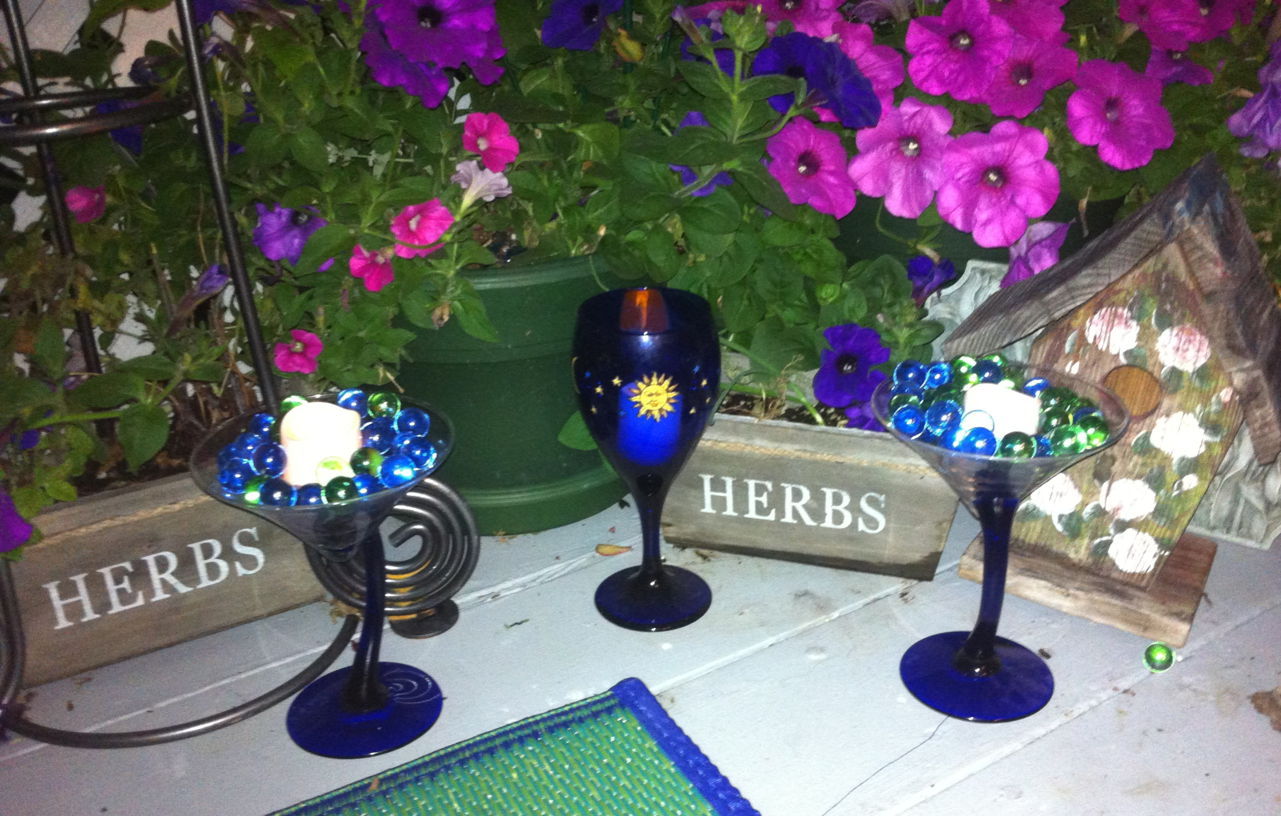 Repurposed Martini and Wine Glasses 8 DIY Patio Accents #trashtotreasure #patio #diy #yard #garden #up-cycle #re-purpose #patio_table #plant_stand #bird_bath #herb_garden #wineglass #martiniglass #candles