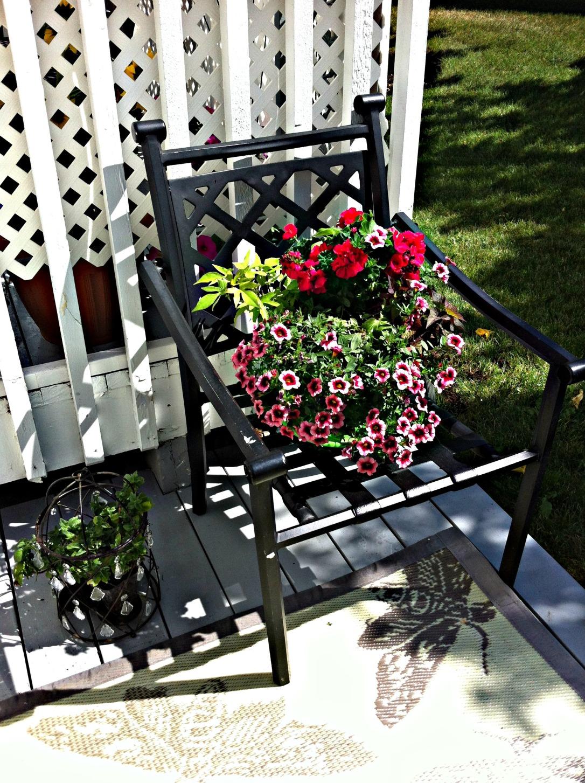 Repurposed Chair Planter 8 DIY Patio Accents #trashtotreasure #patio #diy #yard #garden #up-cycle #re-purpose #patio_table #plant_stand #bird_bath #herb_garden