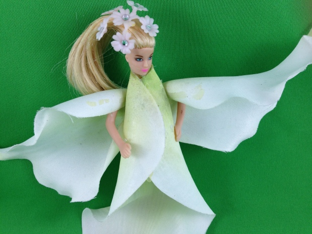 Every now and again I come across an abandon doll at the Thrift Store or garage sale and it pulls on my heart strings so I transform them into flower fairies. My fairies are a little different, they actually become the flower rather than just being dressed in flower outfit. It symbolizes a new start and purpose and they are just fun to do! #Fairy #Flower #Upcycle #Doll #Crafts