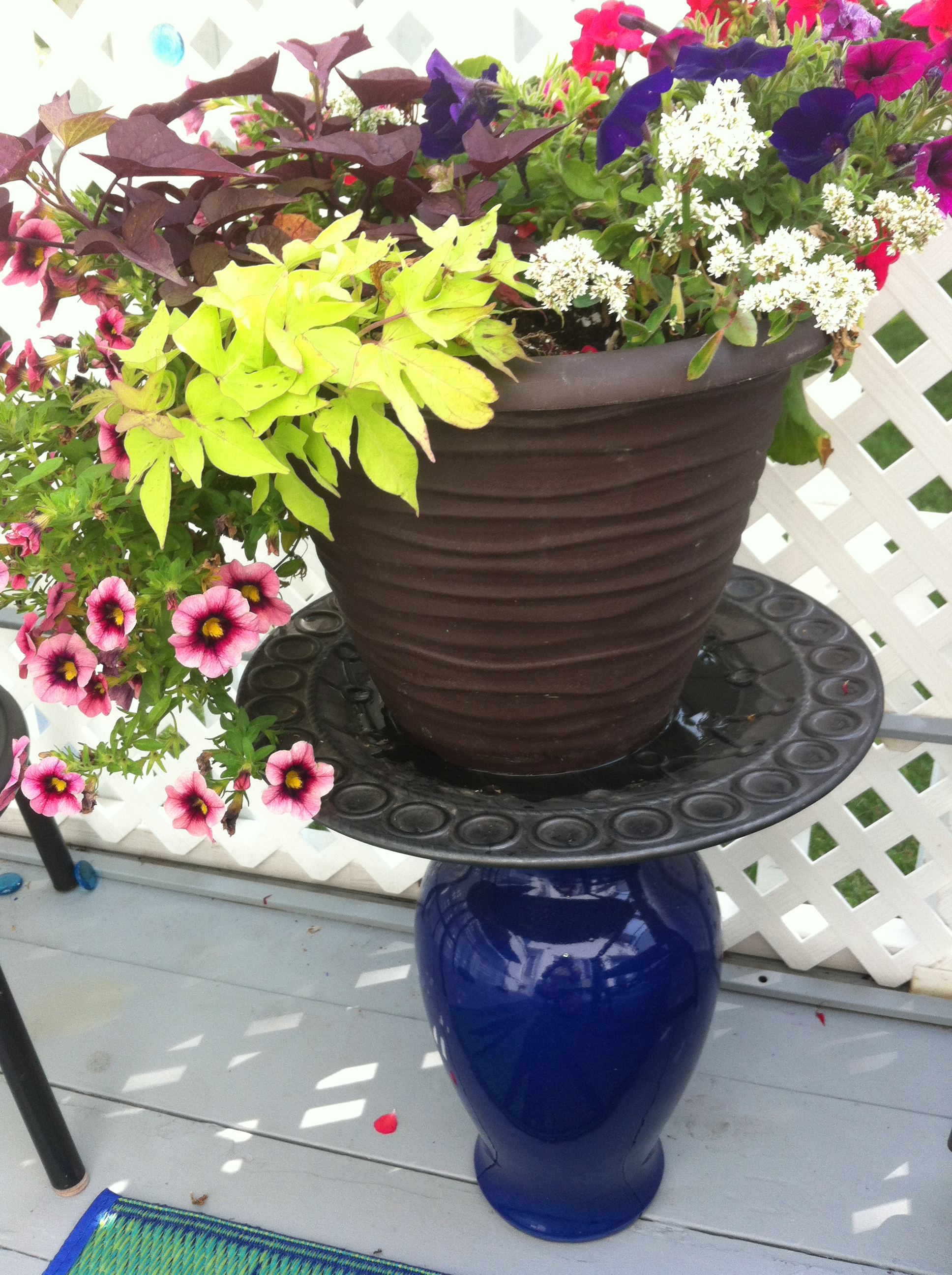 Up-cycled plant stand from vase and platter 8 DIY Patio Accents #trashtotreasure #patio #diy #yard #garden #up-cycle #re-purpose #patio_table #plant_stand #bird_bath #herb_garden