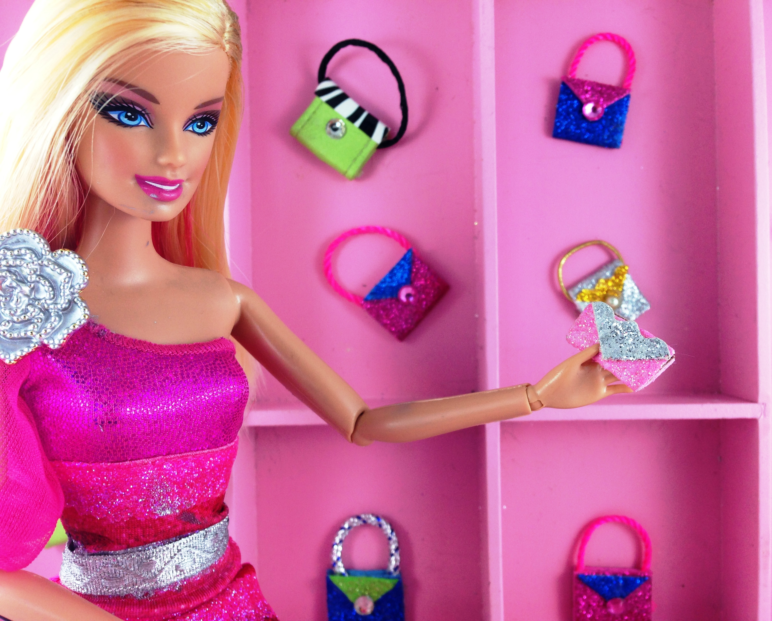 Easy DIY sparkly Barbie Doll purses made with sticky back sparkling foam from dollar store DIY Barbie Doll Easy NoSew Hand Made Purses #barbiedoll #accessories #purses #handmade #sparkle #Starrcreative