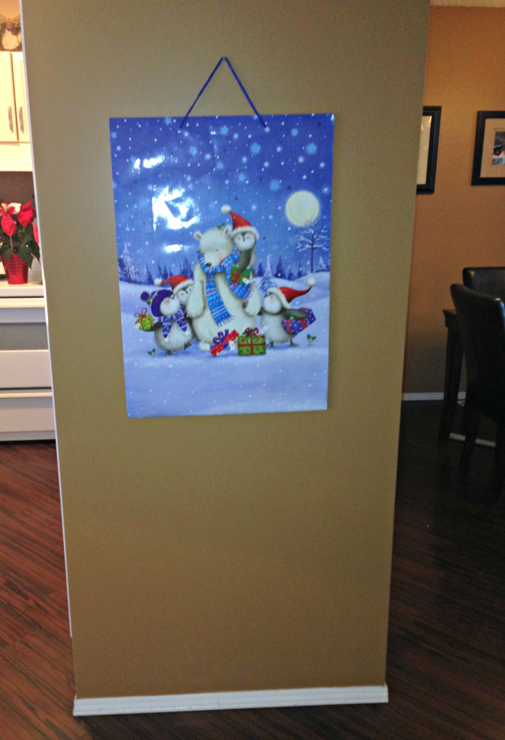 Re-Purposed Gift Bag Christmas Wall Art. Glue bag to foam board and use handle to hang. Easy fun craft for kids and adults. #Christmas #art #crafts #gift_bag