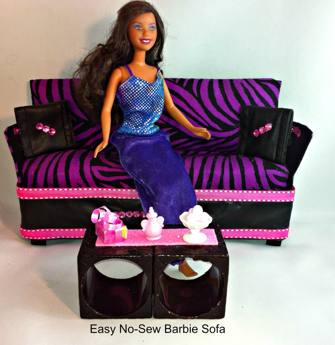 DIY Barbie Doll Couch/Sofa in purple and black zebra print and faux leather accents and coffee table made with up-cycled napkin holders.