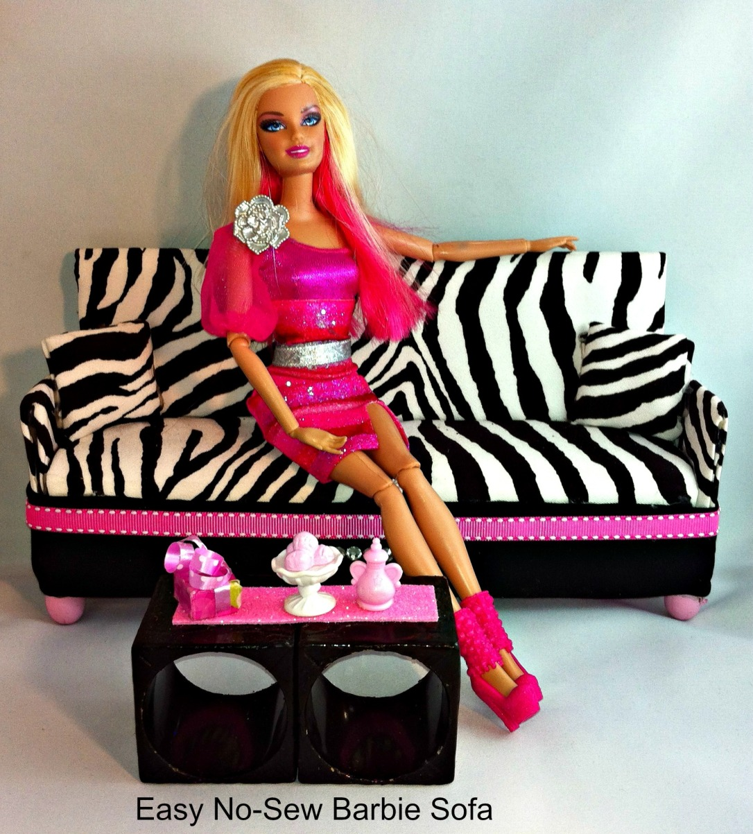 DIY Barbie Doll Couch/Sofa in white and black zebra print and faux leather accents and coffee table made with up-cycled napkin holders.