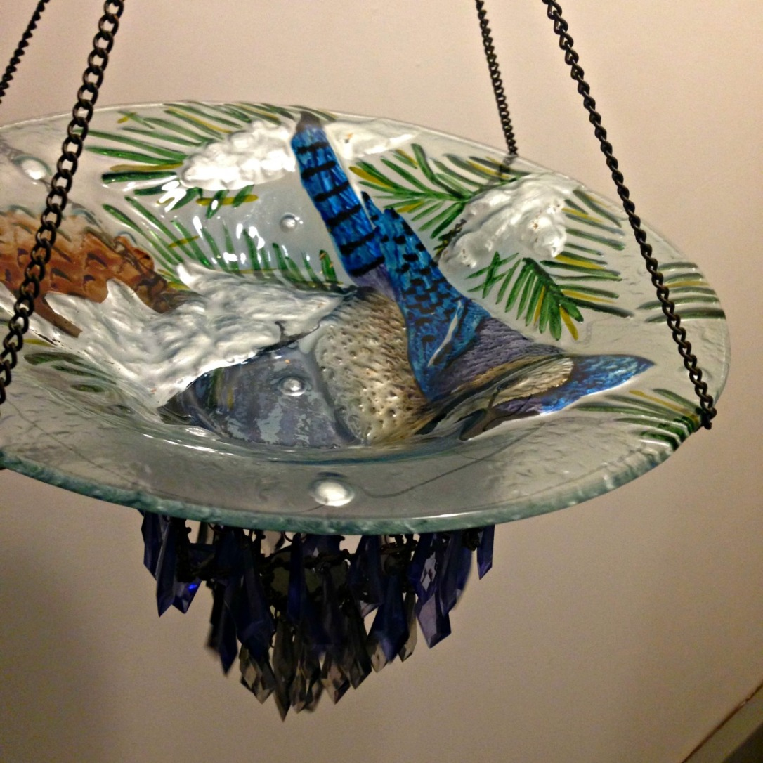 DIY Blue Jay Bird Bath and Bird Feeder made with repurposed vase and hanging crystal candle holder from Thrift Store