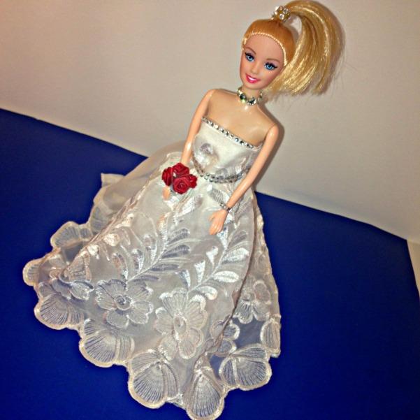 No Sew Barbie Doll Wedding Dress. DIY Wedding gown made from white curtains. Stick on jewel jewellery and DIY bouquet.  #barbiedoll #weddingdress #weddinggown #handmade #nosew #bouquet #weddingjewellery Starrcreative.ca
