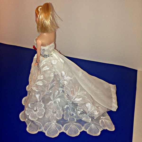 No Sew Barbie Doll Wedding Dress. DIY Wedding gown made from white curtains. Stick on jewel jewellery and DIY bouquet.  #barbiedoll #weddingdress #weddinggown #handmade #nosew #bouquet #weddingjewellery Starrcreative.ca