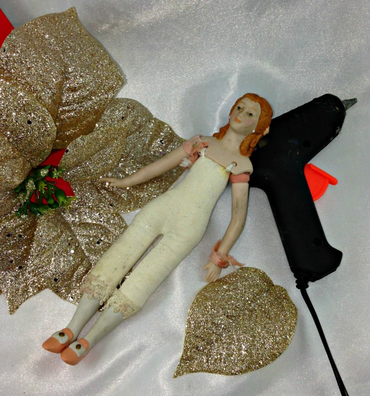 DIY Christmas Poinsettia Angel Fairy. My fairies are abandoned dolls transformed into a flower - a new beginning, a new start. #DIY #Christmas #Poinsettia #Angel #Fairy