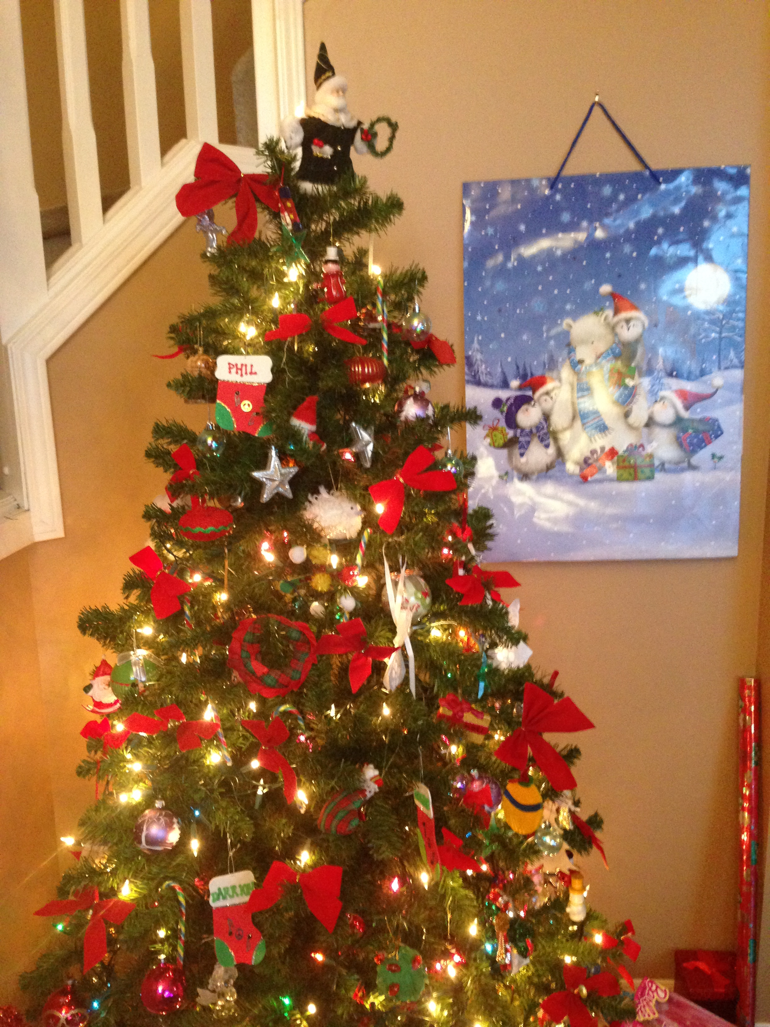 Decorating a Christmas Tree a Christmas Tradition - See more traditions #Christmastree #Decorating #Sant Claus  #Christmas #Traditions#holidays #ornaments #garland #lights #treetopper