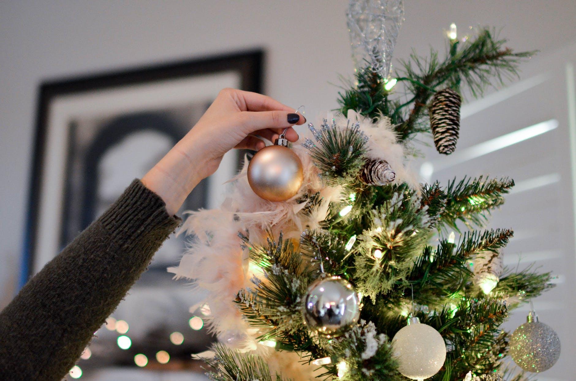 Hanging Christmas ornaments on the Christmas tree a Canadian Tradition #christmas #ornaments #tradition
