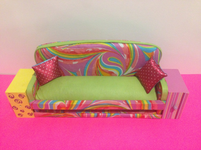 DIY Barbie Doll Couch/Sofa in colorful pink, purple, green, blue print and faux leather accents and coffee table made with up-cycled napkin holders. DIY No Sew Barbie Doll Couch or Sofas and Up-cycled Coffee Table #multicolored #handmade #upcycledspicerack #barbiedoll #furniture #sofa #couch #coffee table #Starrcreative.ca